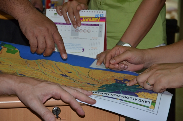 Inspecting land-allocation map Bantaeng district South Sulawesi Indonesia (2)