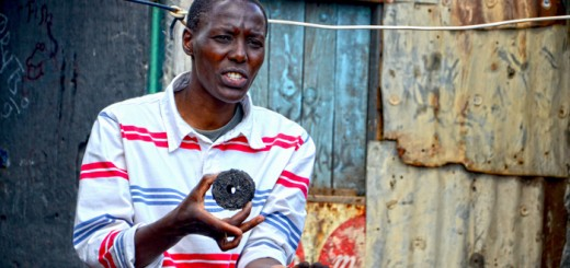 Mary Njenga holding a cooking-fuel briquette. Photo by Sherry Odeyo/ICRAF