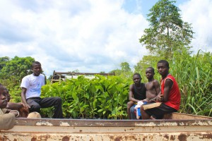This month, Parfait Teia Kouame's family bought a truckload improved cocoa seedlings. Parfait, sitting left, oversees the loading.Photo by Daisy Ouya/ICRAF