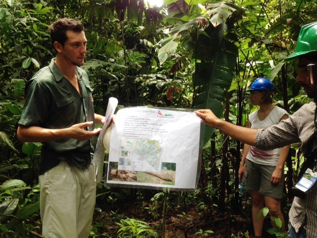 Researchers in Costa Rica examine a map of ecosystem services