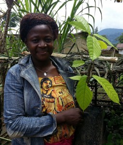 Woman holding a grafted cocoa plant grown in her private nursery in the Efoulan area, Cameroon-Photo by Lalisa A Duguma/ICRAF