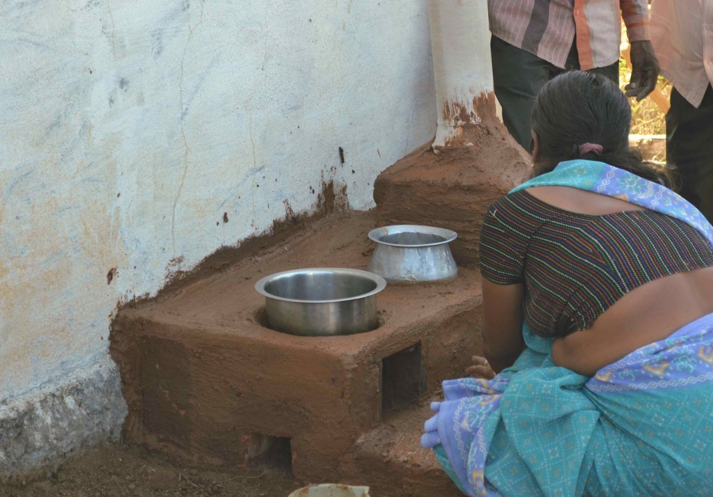 A training participant finishes off her Sarala cook-stove