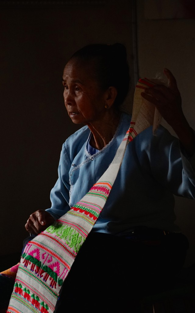 Ethnic Dai lady showing her hand-woven clothes