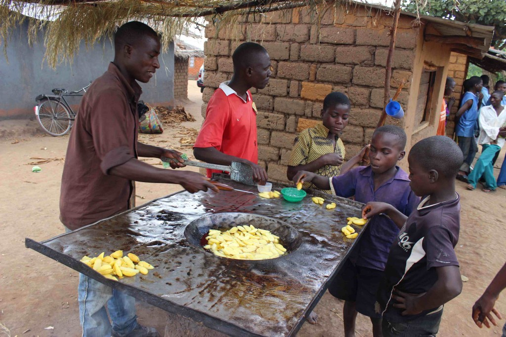 Chisomo Matia has a small business selling fried potatoes made on a wood-fired stove in Kwindanguwo village in Dowa, Malawi. Photo by Daisy Ouya/ICRAF