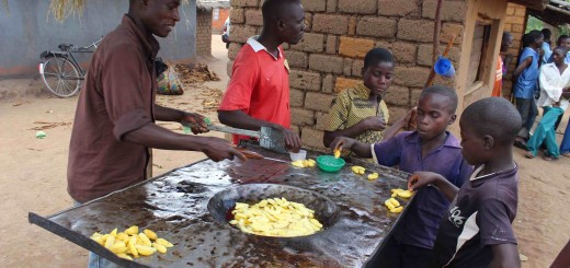 Chisomo Matia has a small business making fried potatoes in a wood-fired stove in Dowa, Malawi. Photo by Daisy Ouya/ICRAF