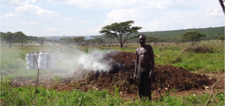A charcoal burner carbonizing charcoal with an earth mound kiln whose efficiency is as low as 10% in a landscape consisting of farmland, grazing land and woodland remnants in Bugesera, Rwanda. Photo credit: Miyuki Iiyama/ICRAF