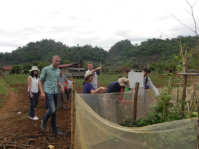 Humidtropics core team members visiting a home garden trial in Thong village. The author is far right. Photo: World Agroforestry Centre/CGIAR Research Program on Integrated Systems for the Humid Tropics/Mai Thanh Tu