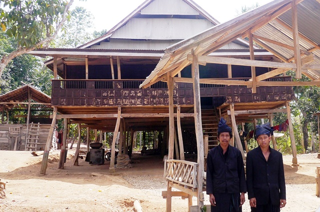 Kajang community members in front of one of the village's uniquely styled homes. Photo: World Agroforestry Centre/Amy Lumban Gaol
