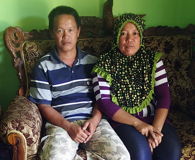 Tawanga headman and his wife posing in their front room, Tawanga, Southeast Sulawesi. Photo: World Agroforestry Centre/Carol Colfer