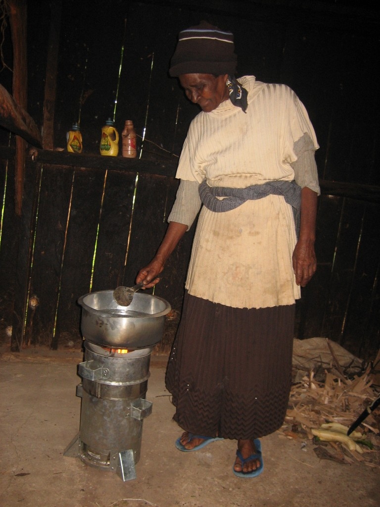 Phylis Njeru, a smallholder farmer from Embu in Kenya, uses a gasifer cook stove to prepare a meal. Photo by Mary Njenga/ World Agroforestry Centre