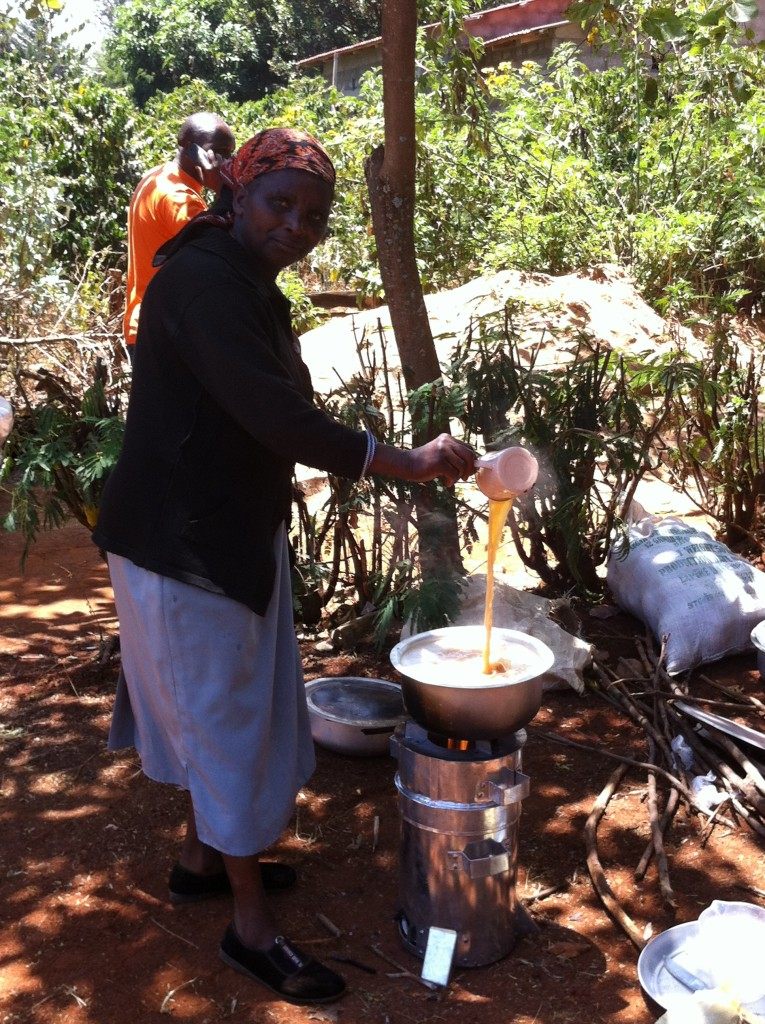 Janet Mbogo prepares tea during a demonstration of use of the gasifier cook stove in Embu. Kenya. Photo by Mary Njenga/ World Agroforestry Centre
