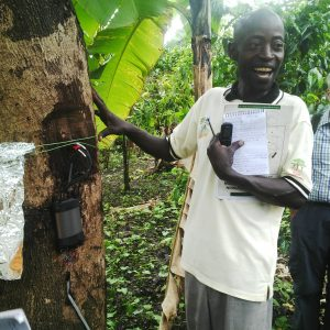 Photo 2a Richard Namunyu explaining how the sap-flow gauge works. Photo May Muthuri
