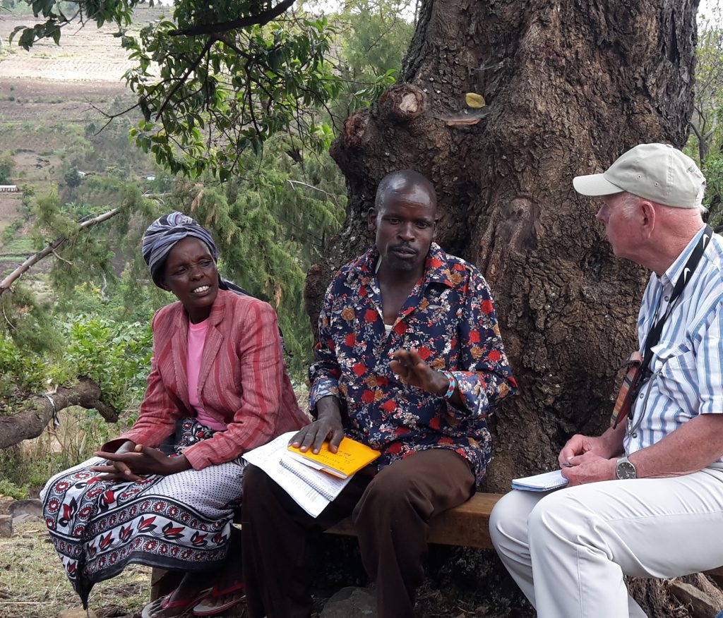 Ebbe interviews Richard Mitei, a poultry lead-farmer the Accelerating the Adoption of Agroforestry project in western Kenya. His wife, a horticulture lead-farmer under the same project. Together, they have improved their family's living standards. Photo: World Agroforestry Centre/ Lisa Fuchs