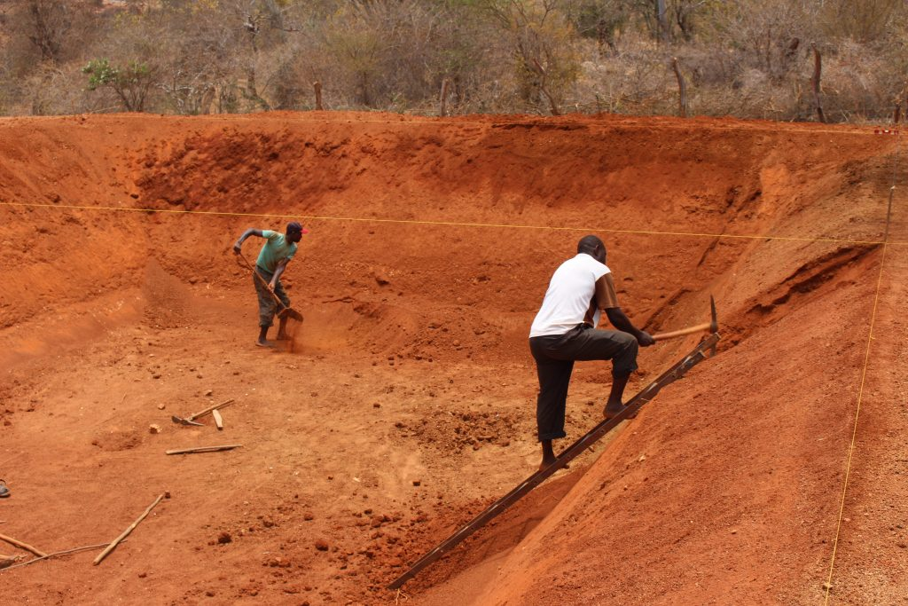 Two men dig a pit for rainwater harvesting in Machakos County, Kenya. Photo: World Agroforestry Centre