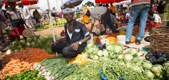 Vegetable seller at local market in Abuja. ©IFPRI/Milo Mitchell, Flickr